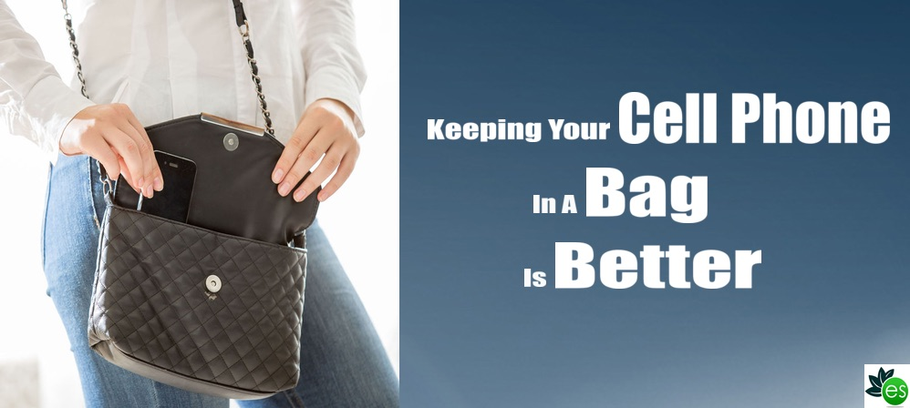 Woman putting cell phone in hand bag